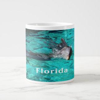 delfín que sale del agua clara florida jpg del tru tazas extra grande