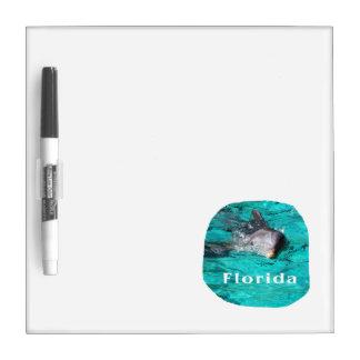 delfín que sale del agua clara la Florida del trul Tableros Blancos