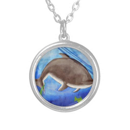 Delfín y pescados grímpola