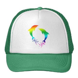 Delfínes de salto del arco iris con las burbujas gorras de camionero