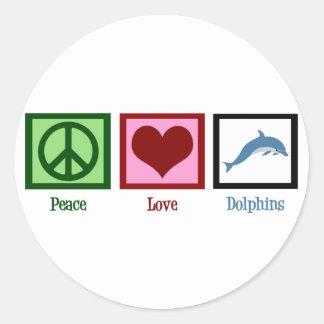 Delfínes del amor de la paz pegatina redonda