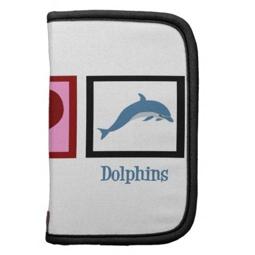 Delfínes del amor de la paz planificadores