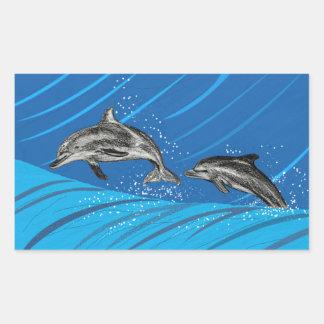 Delfínes del mar azul pegatina rectangular