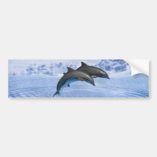 Delfínes en el mar azul claro pegatina de parachoque