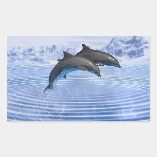 Delfínes en el mar azul claro pegatina rectangular