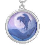 Delfines en la luz de luna joyeria