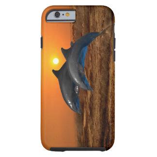 Delfínes en la puesta del sol funda resistente iPhone 6