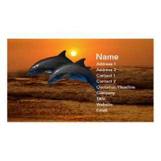 Delfínes en la puesta del sol tarjetas de visita