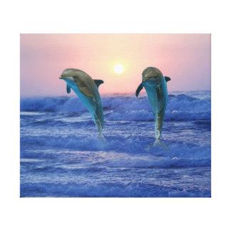 Delfínes en la salida del sol impresión en lienzo