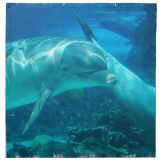 Delfínes juguetones fijados de cuatro servilletas