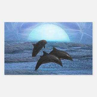 Delfínes que juegan en el claro de luna pegatinas