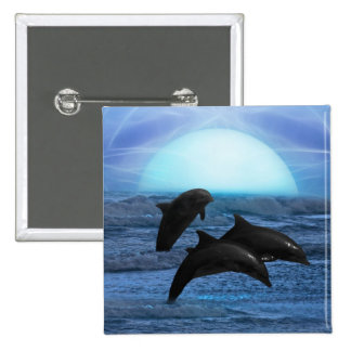 Delfínes que juegan en el claro de luna pins