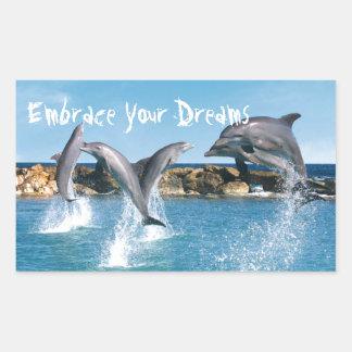 Delfínes que nadan y que hacen trucos pegatina rectangular