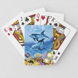 Delfínes y arte tropical de los pescados naipes