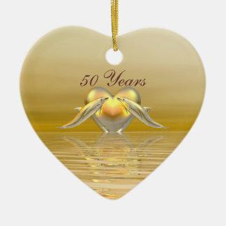 Delfínes y corazón de oro del aniversario ornato