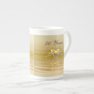 Delfínes y corazón de oro del aniversario taza de té