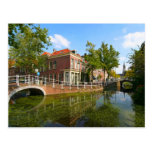 Delft, canal, bridge, and old houses postcards