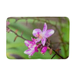 Delicate Pink Orchid in Tropical Garden Bathroom Mat