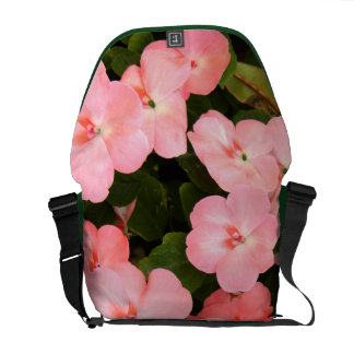 Delicate pink spring flowers courier bag