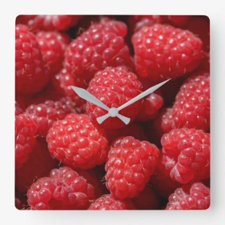 Delicious fresh and sweet red raspberries square wall clock