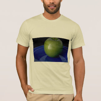 Delicious Green apple on blue plate T-Shirt