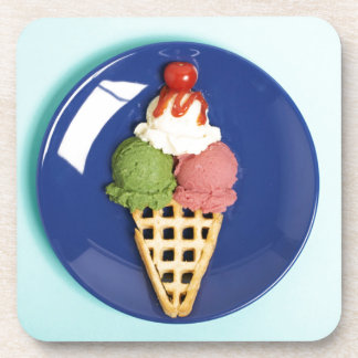 delicious ice cream served on blue plate coasters