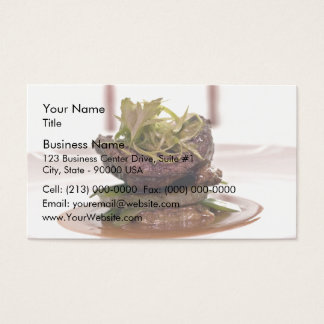Delicious meat filet with curry leaves business card