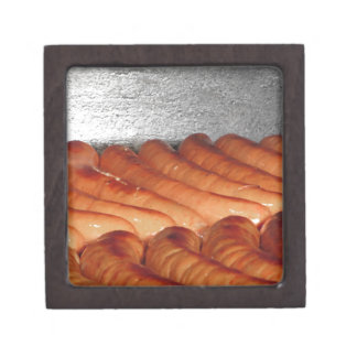 Delicious red baked sausages in row jewelry box