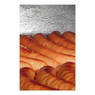 Delicious red baked sausages in row stationery
