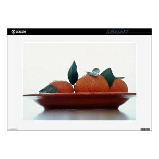 Delicious Tangerine fruits in a bowl Decal For Laptop