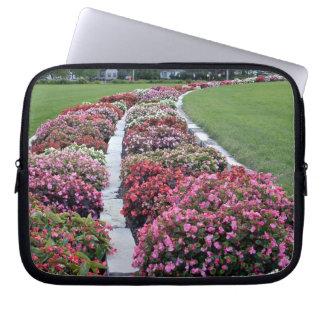 Delightful fresh flowers arrangement in park laptop sleeves