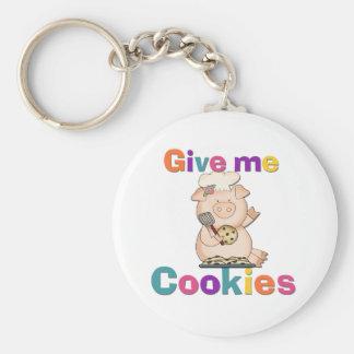 Déme las camisetas y los regalos de las galletas llavero