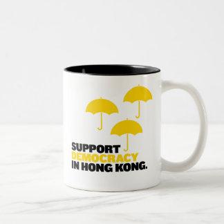 Democracia de la ayuda en taza de café de Hong
