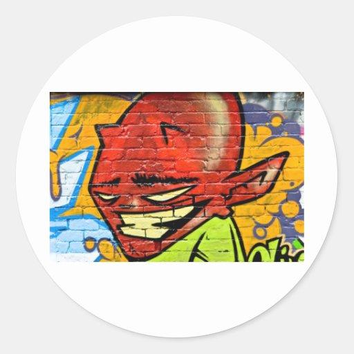 Demonio de la pintada pegatina redonda