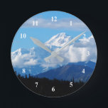 "Denali 101 Clock<br><div class=""desc"">Denali is the highest mountain peak in North America. Located in the Alaska Range in the interior of the U.S. state of Alaska, Denali is the centerpiece of Denali National Park and Preserve. In August 2015, following the 1975 lead of the state of Alaska, the U.S. Department of the Interior...</div>"