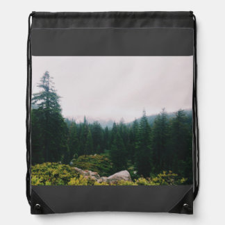 Dense forest of conical trees drawstring bag