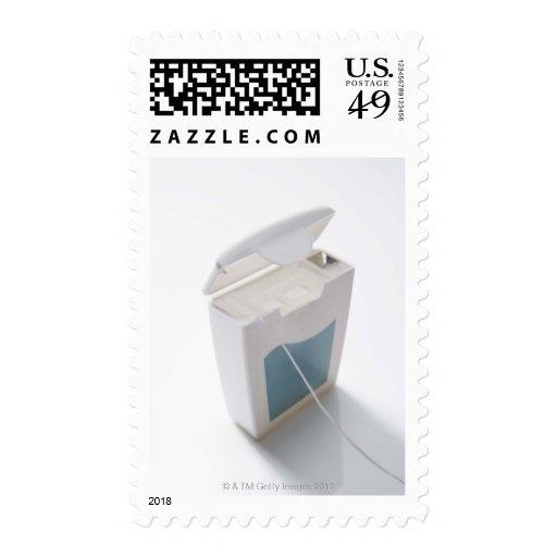 Dental floss stamps