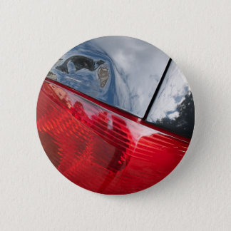 Dented tailgate pinback button