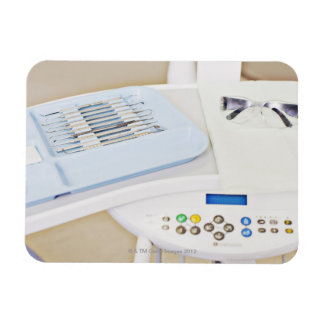 Dentist machinery, safety goggles and implements magnet