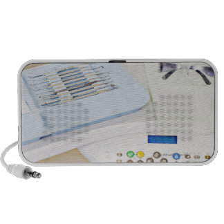 Dentist machinery, safety goggles and implements laptop speaker