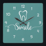 """Dentist Office Clock<br><div class=""""desc"""">Modern Dentist office wall decor clock in a trendy design including a tooth symbol and smile graphic designed with stylish graphic typography and background color you can change if you need to. Designed for a dental office to encourage smiling and a positive attitude.</div>"""