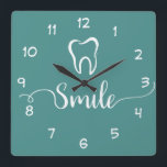 "Dentist Office Clock<br><div class=""desc"">Modern Dentist office wall decor clock in a trendy design including a tooth symbol and smile graphic designed with stylish graphic typography and background color you can change if you need to. Designed for a dental office to encourage smiling and a positive attitude.</div>"