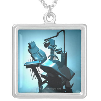 Dentist's chair, computer artwork. silver plated necklace