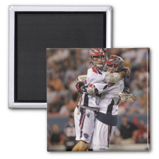 DENVER, CO - JULY 30:  Brad Ross #10 and Max 2 2 Inch Square Magnet