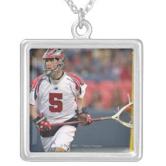 DENVER, CO - JULY 3: Goalie Jordan Burke #5 Necklaces