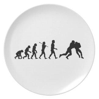 Deportes de la diversión de la evolución del fútbo plato