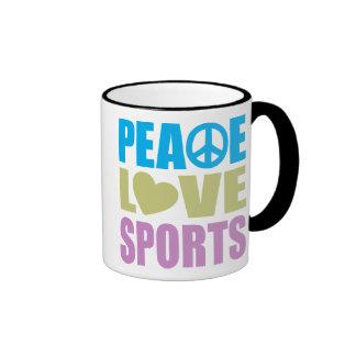 Deportes del amor de la paz taza