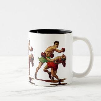 Deportes del vintage, boxeadores en una lucha del taza de dos tonos