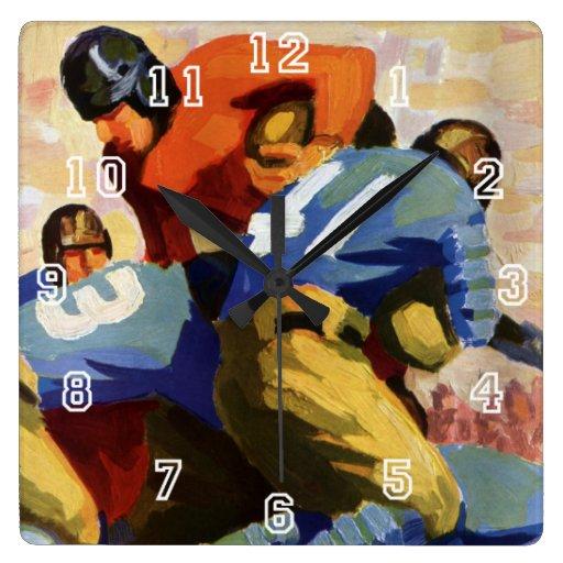 Deportes del vintage, futbolistas en un juego reloj cuadrado