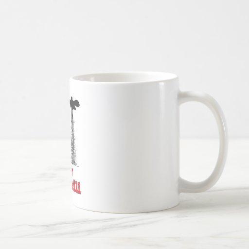 derramamiento del bebé del derramamiento… taza de café